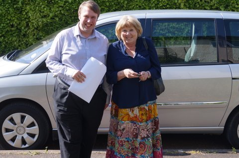 Lloyd Knight and Cllr Jenny Roach standing outside in front of a silver car.